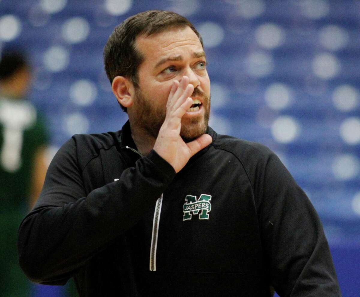 Manhattan head coach Steve Masiello shouts to his team during practice for an NCAA college basketball first round game Monday, March 16, 2015, in Dayton, Ohio. Manhattan plays Hampton in Dayton on Tuesday. (AP Photo/Skip Peterson) ORG XMIT: OHSP108