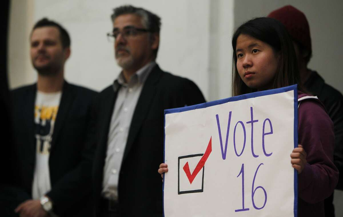 Anna He, a 16-year-old Junior at Lowell High School, holds a sign while guest speakers address the crowd during a rally held by the San Francisco Youth Commission at City Hall in San Francisco, Calif. Monday, March 16, 2015 to shine light on new legislation to allow 16 and 17-year-olds to vote in San Francisco.