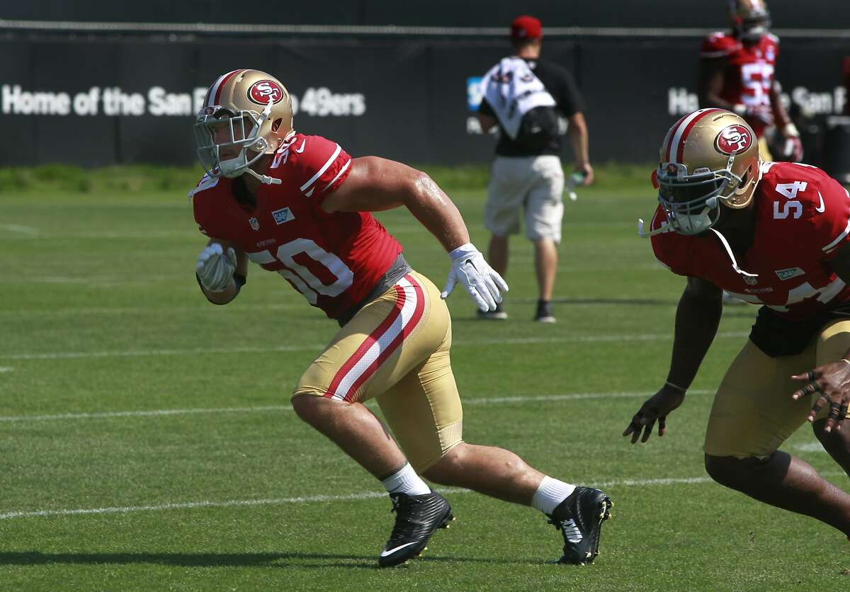 Linebacker Chris Borland (50) practices with teammate Nick Moody during the San Francisco 49ers training camp in Santa Clara, Calif. on Tuesday, July 29, 2014.