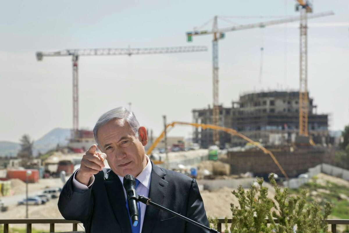 Israeli Prime Minister Benjamin Netanyahu talks as he visits a construction site in Har Homa, east Jerusalem, Monday March 16, 2015, a day ahead of legislative elections. Netanyahu is seeking his fourth term as prime minister. (AP Photo/Olivier Fitoussi) ORG XMIT: DV801