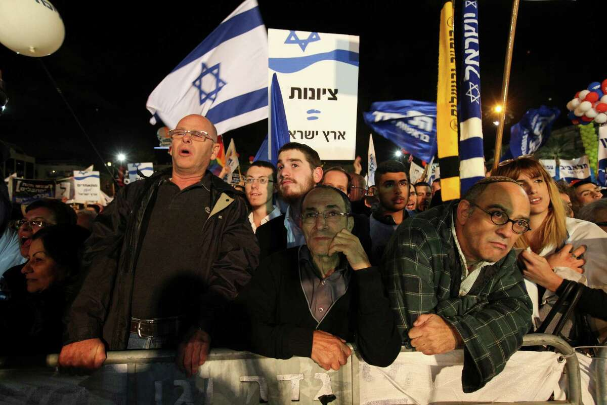 Supporters of Israeli Prime Minister Benjamin Netanyahu gather during his election rally in Tel Aviv, Israel, Sunday, March 15, 2015, two days ahead of legislative elections. Netanyahu seeks his fourth term as the Prime Minister. (AP Photo/Ariel Schalit) ORG XMIT: DV111