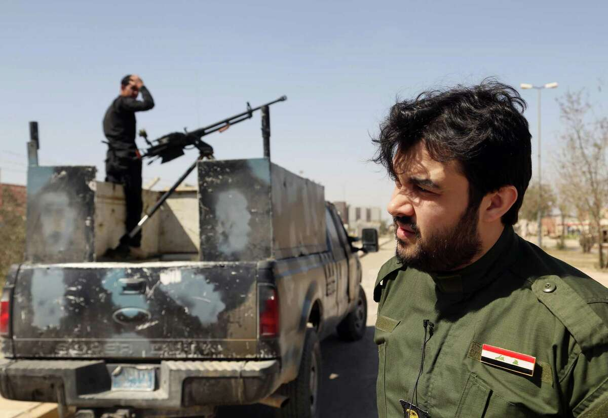 Yazan al-Jabouri, right, a member of one of Iraq?'s most prominent tribes, speaks during an interview with The Associated Press in Tikrit, 130 kilometers (80 miles) north of Baghdad, Iraq, Monday, March 16, 2015. For months, al-Jabouri was living in fear of crossing paths with a fighter from the Islamic State group. He had refused to pledge loyalty to the extremist group, and letters had been left on his doorstep threatening to cut his head off. His wife and children also were threatened. ?