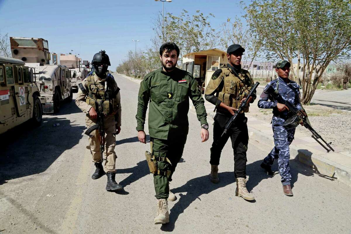 Yazan al-Jabouri, center, a member of one of Iraq?'s most prominent tribes, walks with his colleagues at the front line during a battle against Islamic State militants in Tikrit, 130 kilometers (80 miles) north of Baghdad, Iraq, Monday, March 16, 2015. For months, al-Jabouri was living in fear of crossing paths with a fighter from the Islamic State group. He had refused to pledge loyalty to the extremist group, and letters had been left on his doorstep threatening to cut his head off. His wife and children also were threatened. ?