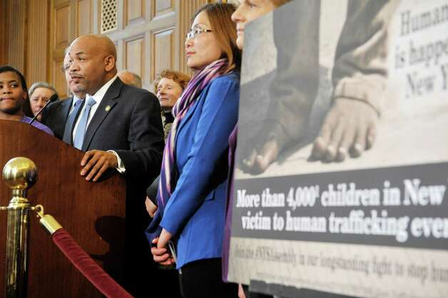 Assembly Speaker Carl Heastie, at podium, members of the Assembly Majority, survivors of sex trafficking and advocates for the survivors take part in a press conference to discuss human trafficking legislation on Monday, March 16, 2015, at the Capitol in Albany, N.Y.  (Paul Buckowski / Times Union) Photo: PAUL BUCKOWSKI / 00031049A