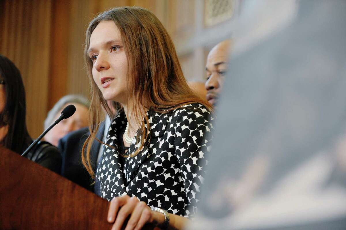Iryna, a New York resident who was forced into prostitution by her boyfriend, talks about her ordeal during a press conference to discuss human trafficking legislation that the Assembly will take up on Monday, March 16, 2015, at the Capitol in Albany, N.Y. (Paul Buckowski / Times Union)