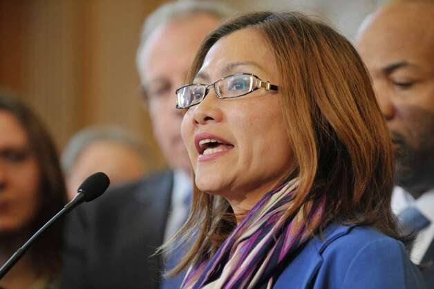 Shandra Woworuntu, a survivor of sex trafficking and the founder of Mentari, a trafficking survivor empowerment program, talks about her ordeal during a press conference to discuss human trafficking legislation that the Assembly will take up on Monday, March 16, 2015, at the Capitol in Albany, N.Y.  (Paul Buckowski / Times Union) Photo: PAUL BUCKOWSKI / 00031049A