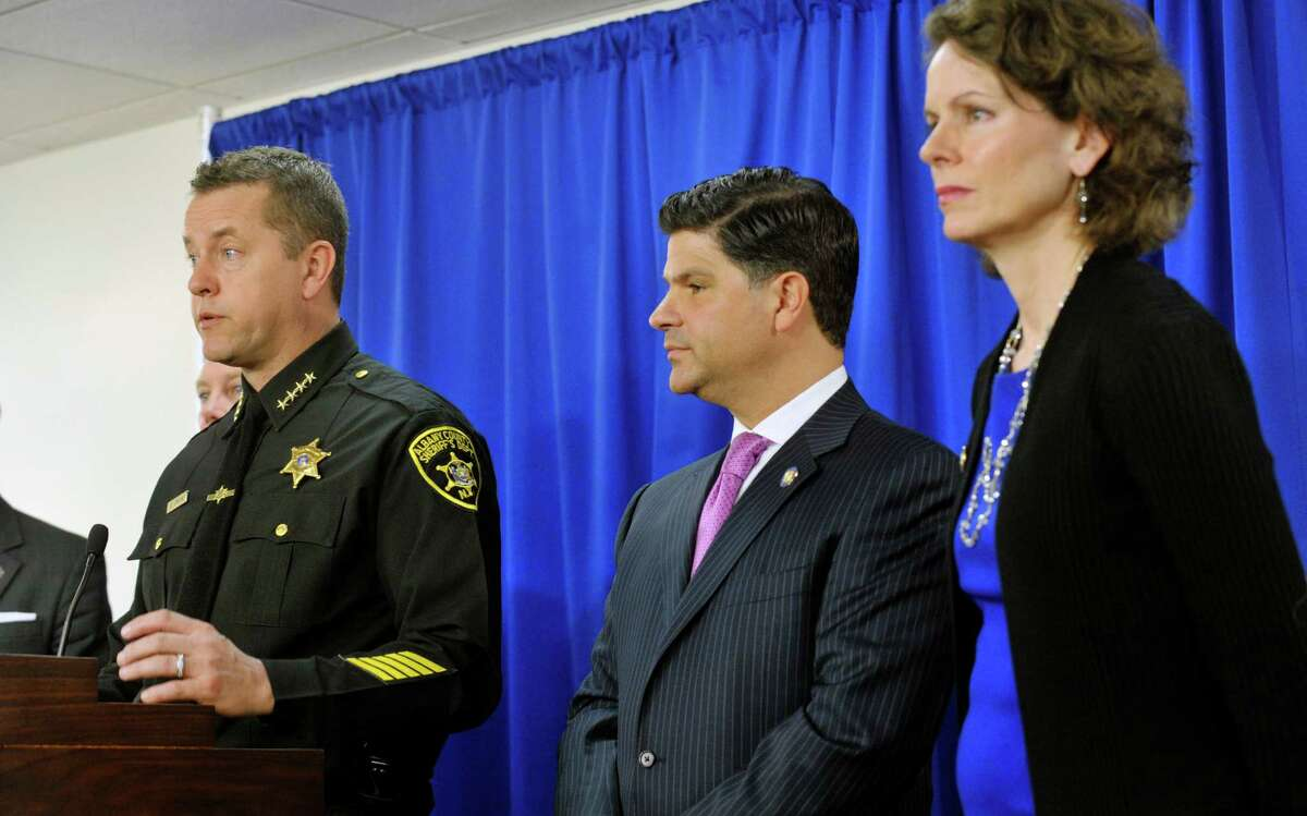 Albany County Sheriff Craig Apple, left, answers questions from the media on Monday, March 16, 2015, in Albany, N.Y., as Senator George Amedore, second from left, and Assemblywoman Patricia Fahy look on during a press conference to discuss new legislation that would expedite access to CPS records when law enforcement is investigating a missing child. When the legislators held the press conference the bill had not yet passed but the Senate and Assembly were both taking up the bill later on Monday. (Paul Buckowski / Times Union)