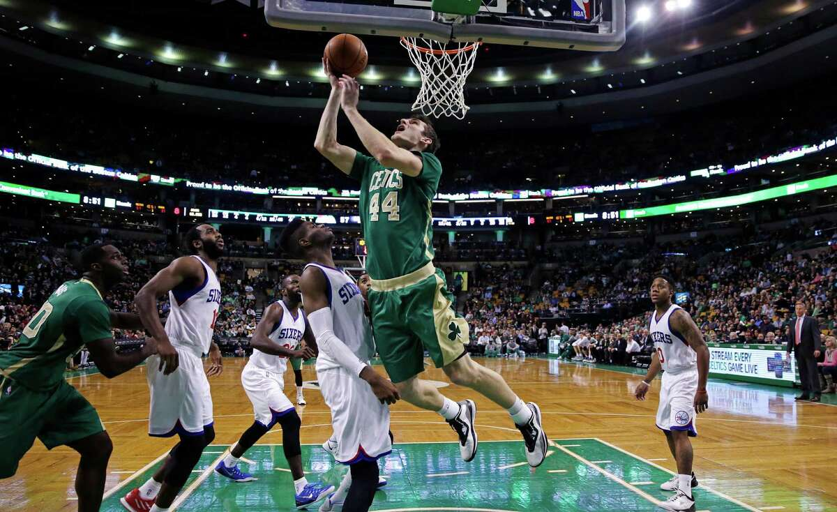 Boston Celtics center Tyler Zeller (44) drives to the basket against the Philadelphia 76ers during the second half of an NBA basketball game in Boston, Monday, March 16, 2015. Zeller had 26 points as the Celtics defeated the 76ers 108-89. (AP Photo/Charles Krupa) ORG XMIT: MACK109