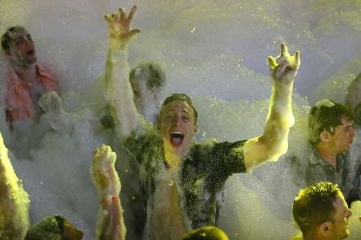 Spring Breakers are covered in foam at The City nightclub in the Caribbean resort city of Cancun, Mexico, early Monday, March 16, 2015. Cancun continues to be one of the top foreign destinations for U.S. college students to spend Spring Break.  Photo: Israel Leal, Associated Press