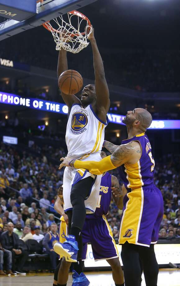 Golden State Warriors' Festus Ezeli dunks against Los Angeles Lakers' Carlos Boozer in 2nd quarter during NBA game at Oracle Arena in Oakland, Calif., on Monday, March 16, 2015. Photo: Scott Strazzante, The Chronicle