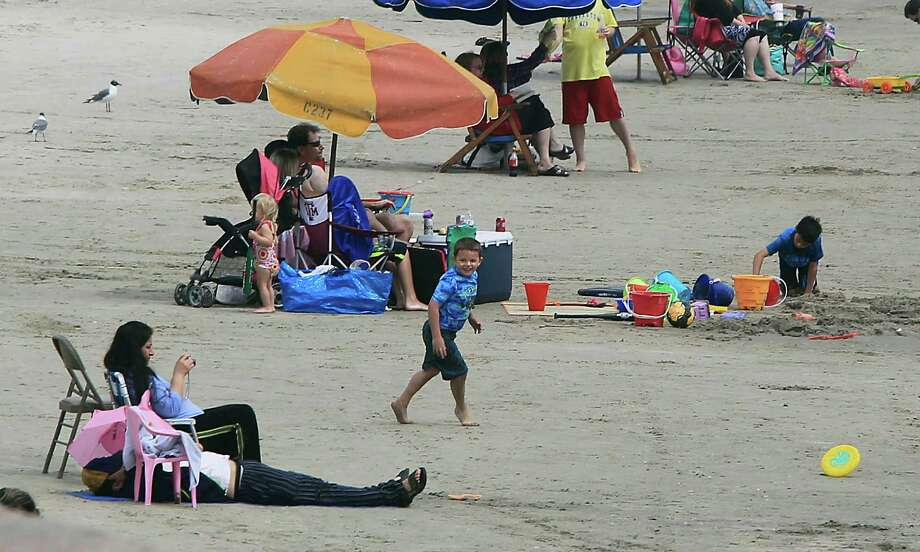 A light crowd on a the beach near 10th street Monday, March 16, 2015, in Galveston. Photo: James Nielsen, Houston Chronicle / © 2015  Houston Chronicle