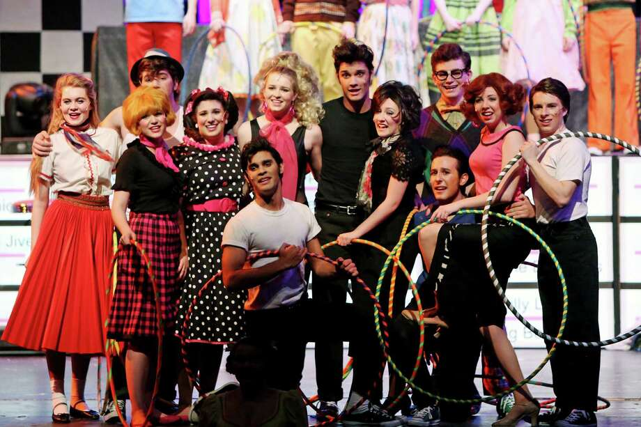 "A scene from New Canaan High School's stage production of ""Grease"", from left, Kenon Lysenko,  Braian Qela (rear), Anna Oxman (in front of Braian), Lauren Mellinger, Elizabeth Koennecke, Deven Appel, Nancy Leville, Jack Dahill, Audrey Kirkpatrick, and Jacob Freedgood. Kneeling in front are Shaan Appel and Nick Ranieri. Photo: Contributed Photo / New Canaan News"