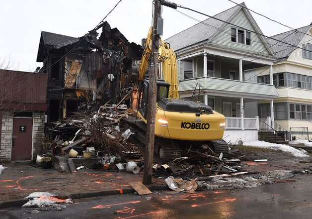 The house at 234 Delaware Av in Albany being torn down after late Monday evening. (Skip Dickstein)