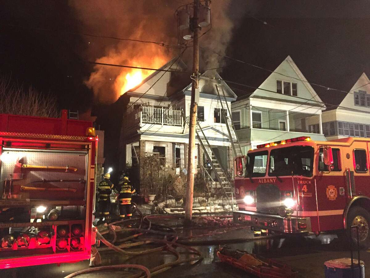 The Albany Fire Department said 11 people were displaced and three Albany firefighters slightly injured after a fire late on March 16, 2015, at 234 Delaware Ave. (Tom Heffernan Sr./Special to the Times Union)
