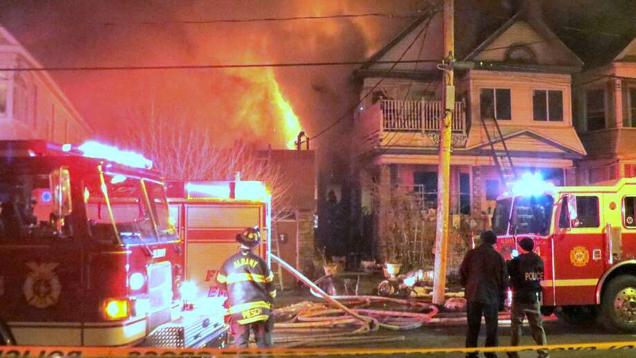 The Albany Fire Department said 11 people were displaced and three Albany firefighters slightly injured after a fire late on March 16, 2015, at 234 Delaware Ave. (Tom Heffernan Sr./Special to the Times Union) Photo: Picasa
