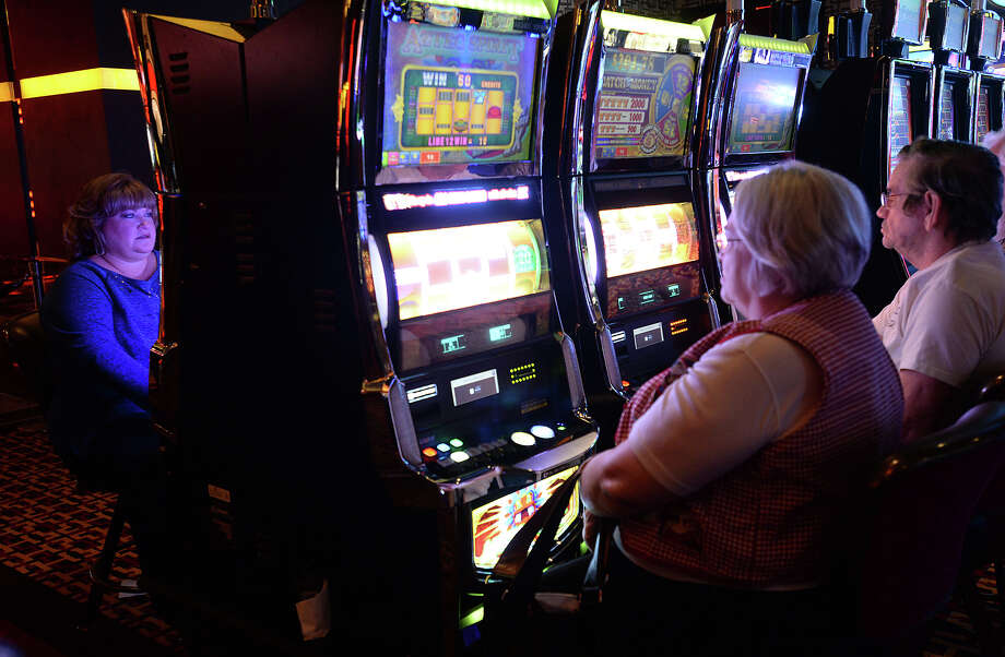 Patrons fill the rows of slot machines on the opening day of the Golden Nugget Casino in Lake Charles, LA, Monday.