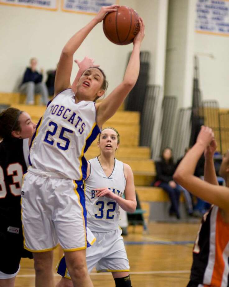 Brookfield's Krista Melchione grabs an offensive rebound in the Bobcats' state Class M Tournament second round game against Montville Friday night at Brookfield High. Photo: Barry Horn / The News-Times Freelance