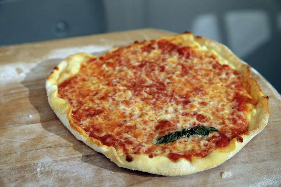A small cheese pizza made by Chronicle writer Tara Duggan and her two daughters as they baked pizza for dinner at their home in San Francisco, Calif,. on Wednesday, January 21, 2015. Photo: Carlos Avila Gonzalez, Staff Photographer / ONLINE_YES