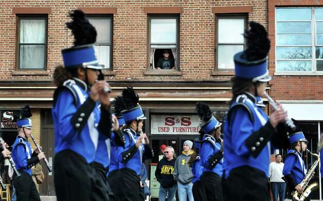 People watch and listen to the Albany Marching Falcons marching band perform as they take part in the Albany Veterans Day parade on Tuesday, Nov. 11, 2014, in Albany, N.Y.   (Paul Buckowski / Times Union archive) Photo: Paul Buckowski / 00029393A