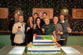 """Josh Hopkins (fourth from right) and the rest of the cast toast the 100th episode of """"Cougar Town"""" in November."""
