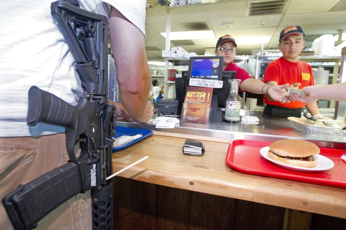 After walking with their guns through downtown as part of a pro-gun rally, the group of about 25 people with the organization, Come and Take it Houston, ate lunch at Tony's BBQ & Steak House, which they said was a gun-friendly establishment Thursday, July 4, 2013, in Houston.