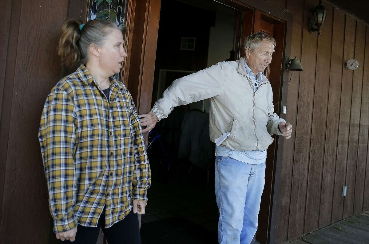 Kelly Hazen (left) and her father Gerald live the closest to the Dahl winery and said Dahl seemed like a pleasant man and couldn't believe he was in great debt Tuesday March 17, 2015. Robert Dahl, who recently achieved his dream of opening a winery near Napa, Calif., shot and killed his investor in a bitter legal battle and then allegedly took his own life as the police closed in.