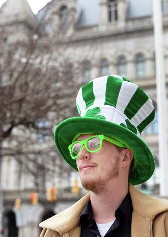 Jason Cronk of Albany celebrates St. Patrick's Day with a shamrock hat and green glasses outside the Capitol Tuesday March 17, 2015 in Albany, NY.  (John Carl D'Annibale / Times Union) Photo: John Carl D'Annibale, Albany Times Union