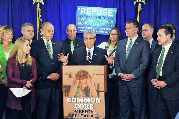 Assemblyman James Tedisco, center, joins with other legislators, parents and educators to call for passage of new Common Core Parental Refusal Act legislation during a news conference in the LOB Tuesday March 17, 2015 in Albany, NY.   (John Carl D'Annibale / Times Union) Photo: John Carl D'Annibale, Albany Times Union / 00031060A