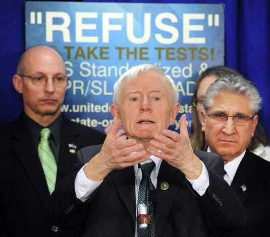 Retired Shenendehowa teacher Anthony McCann, center, makes an impassioned plea during a news conference for passage of new Common Core Parental Refusal Act legislation in the LOB Tuesday March 17, 2015 in Albany, NY.  At right is Assemblyman James Tedisco.  (John Carl D'Annibale / Times Union) Photo: John Carl D'Annibale, Albany Times Union / 00031060A