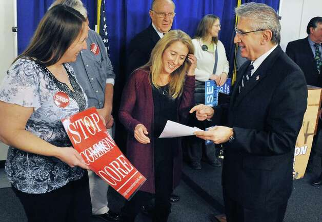 Parents Briana Bays, left, of Clifton Park, and Tricia Farmer of Burnt Hills speak with Assemblyman James Tedisco, right, before a news conference for passage of new Common Core Parental Refusal Act legislation in the LOB Tuesday March 17, 2015 in Albany, NY.  (John Carl D'Annibale / Times Union) Photo: John Carl D'Annibale, Albany Times Union / 00031060A