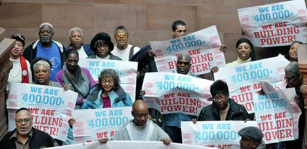 Public housing residents and advocates for public housing take part in a rally on the steps of the Million Dollar Staircase on Monday, March 16, 2015, in Albany, N.Y.  The groups were asking for money funding for public housing in the budget.  (Paul Buckowski / Times Union) Photo: PAUL BUCKOWSKI, Albany Times Union / 00031048A