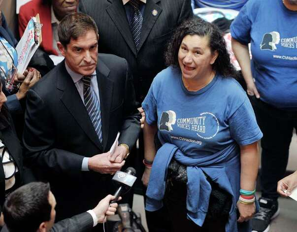Senator Jeff Klein, left, listens as Agnes Rivera, a resident of Wagner House in Manhattan, addresses those gathered for a rally held by public housing residents and advocates for public housing on the steps of the Million Dollar Staircase on Monday, March 16, 2015, in Albany, N.Y.   (Paul Buckowski / Times Union) Photo: PAUL BUCKOWSKI, Albany Times Union / 00031048A