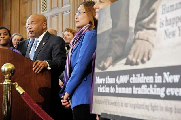 Assembly Speaker Carl Heastie, at podium, members of the Assembly Majority, survivors of sex trafficking and advocates for the survivors take part in a press conference to discuss human trafficking legislation on Monday, March 16, 2015, at the Capitol in Albany, N.Y.  (Paul Buckowski / Times Union) Photo: PAUL BUCKOWSKI, Albany Times Union / 00031049A
