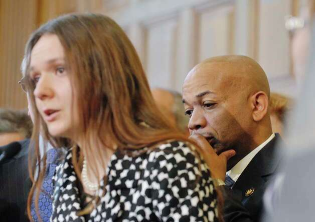 Assembly Speaker Carl Heastie, right, listens as Iryna, left, a New York resident who was forced into prostitution by her boyfriend, talks about her ordeal during a press conference to discuss human trafficking legislation that the Assembly will take up on Monday, March 16, 2015, at the Capitol in Albany, N.Y.  (Paul Buckowski / Times Union) Photo: PAUL BUCKOWSKI, Albany Times Union / 00031049A