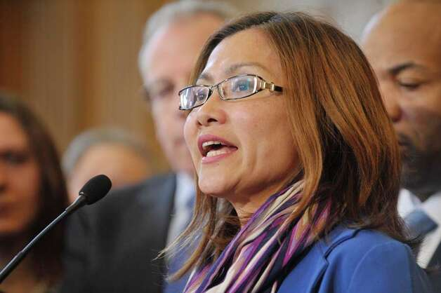 Shandra Woworuntu, a survivor of sex trafficking and the founder of Mentari, a trafficking survivor empowerment program, talks about her ordeal during a press conference to discuss human trafficking legislation that the Assembly will take up on Monday, March 16, 2015, at the Capitol in Albany, N.Y.  (Paul Buckowski / Times Union) Photo: PAUL BUCKOWSKI, Albany Times Union / 00031049A