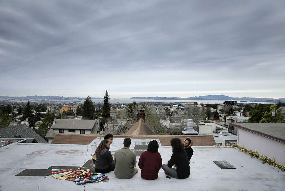 Members of the UC Berkeley Black Student Union's demands committee gather on the roof at Afro House to discuss strategy on Monday. The group wants administrators to improve life for the university's black students. Photo: Carlos Avila Gonzalez, The Chronicle