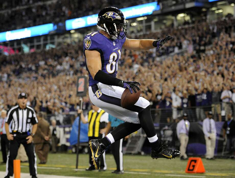 Baltimore Ravens tight end Owen Daniels celebrates his touchdown reception during the first half of an NFL football game against the Pittsburgh Steelers on Thursday, Sept. 11, 2014, in Baltimore. (AP Photo/Nick Wass) Photo: Nick Wass, Associated Press