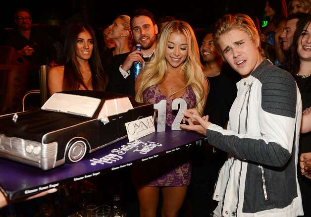 Justin Bieber poses with a birthday cake as he celebrates his 21st birthday at OMNIA Nightclub, Las Vegas in Caesars Palace on March 14, 2015 in Las Vegas, Nevada. Photo: Denise Truscello, WireImage