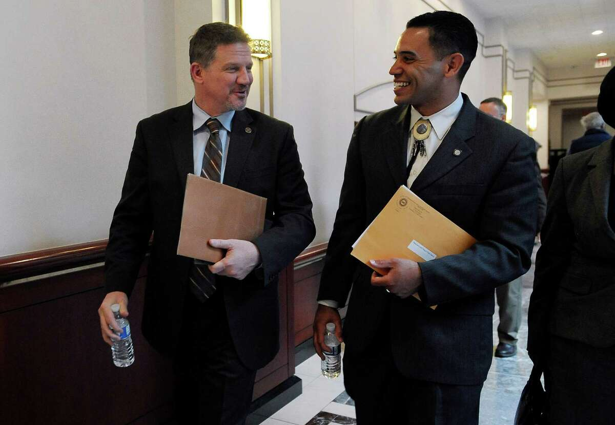 Kevin Brown, chairman of the Mohegan Tribe, left, and Rodney Butler, chairman of the Mashantucket Pequot Tribal Nation leave a hearing at the Legislative Office Building, Tuesday, March 17, 2015, in Hartford, Conn. The chairmen of Connecticut's two federally recognized Indian tribes testified, warning lawmakers that a new casino in neighboring Springfield, Massachusetts, could cost the state as many as 18,000 jobs unless steps are taken to address the competition.