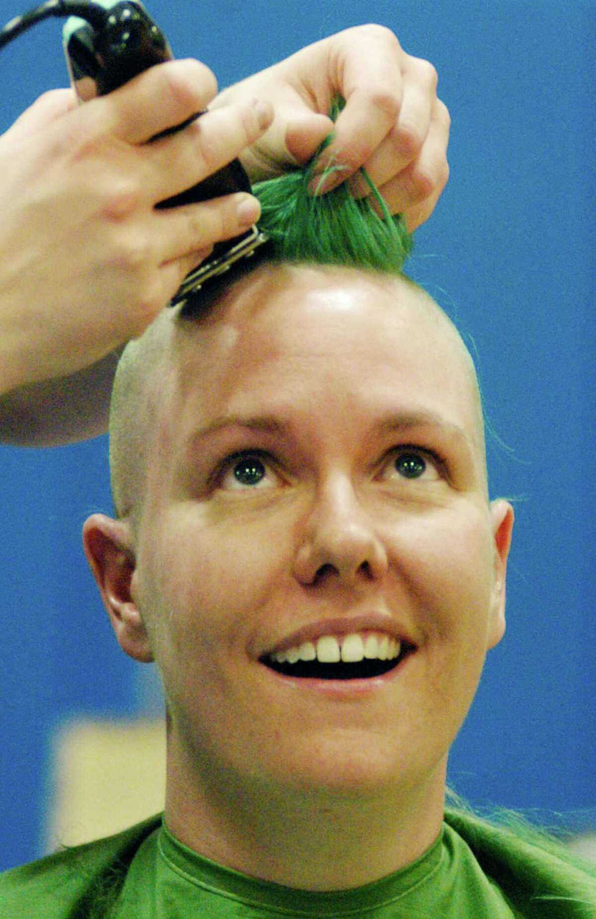 Never let it be said Linda Scoralick lacks moxie. The New Milford High School teacher was one of more than 30 staff and students who had their hair shaved off Monday, March 15, 2015 by area hair stylists to help raise funds for the St. Baldrick's Foundation. The foundation is an international organization that helps fundchildren's cancer research.