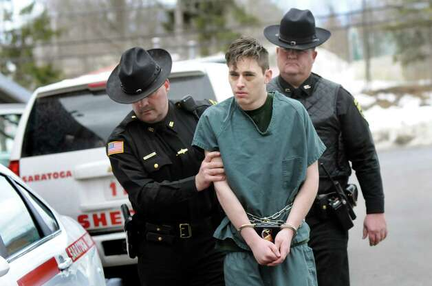 Cody Clements,19, of the Town of Saratoga, is led into court for a hearing on Tuesday, March 17, 2015, at Saratoga Town Court in Schuylerville, N.Y. Clements was charged with felony first-degree assault after allegedly slashing his 10-year-old brother's throat at their home. (Cindy Schultz / Times Union) Photo: Cindy Schultz / 00031066A