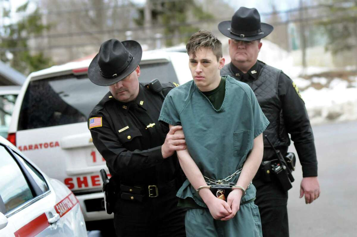 Cody Clements,19, of the Town of Saratoga, is led into court for a hearing on Tuesday, March 17, 2015, at Saratoga Town Court in Schuylerville, N.Y. Clements was charged with felony first-degree assault after allegedly slashing his 10-year-old brother's throat at their home. (Cindy Schultz / Times Union)