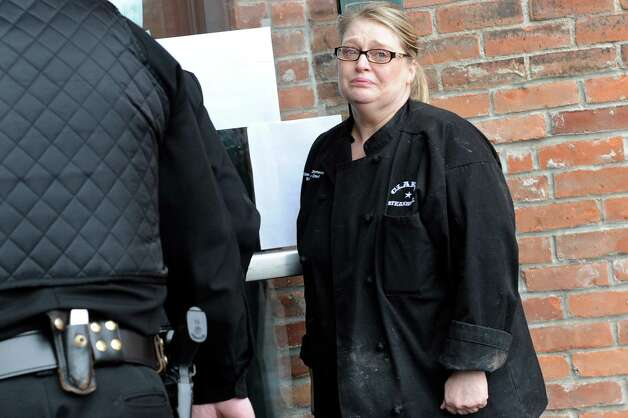 Tina Marie Clements, mother of Cody Clements,19, holds the door as her son is led into court for a hearing on Tuesday, March 17, 2015, at Saratoga Town Court in Schuylerville, N.Y. Cody Clements was charged with felony first-degree assault after allegedly slashing his 10-year-old brother's throat at their home. (Cindy Schultz / Times Union) Photo: Cindy Schultz / 00031066A