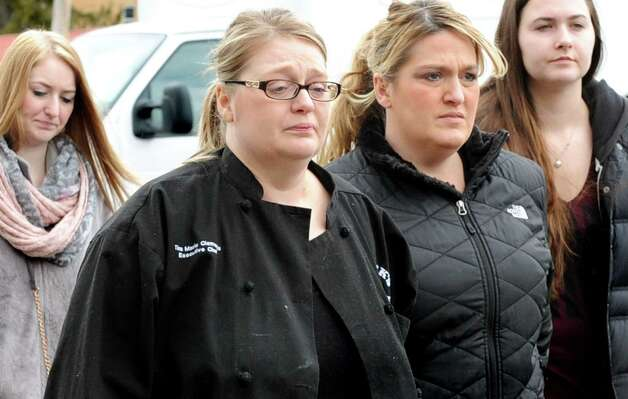 Tina Marie Clements, center, mother of Cody Clements,19, arrives at court for her son's hearing on Tuesday, March 17, 2015, at Saratoga Town Court in Schuylerville, N.Y. Cody Clements was charged with felony first-degree assault after allegedly slashing his 10-year-old brother's throat at their home. (Cindy Schultz / Times Union) Photo: Cindy Schultz / 00031066A