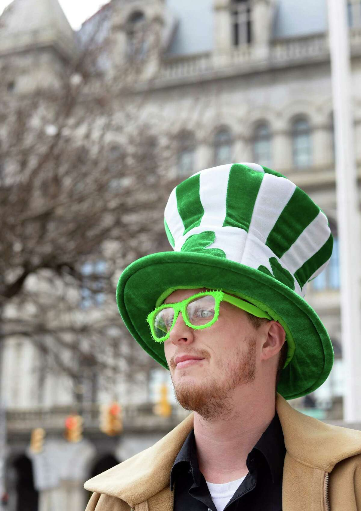 Jason Cronk of Albany celebrates St. Patrick's Day with a shamrock hat and green glasses outside the Capitol Tuesday March 17, 2015 in Albany, NY. (John Carl D'Annibale / Times Union)