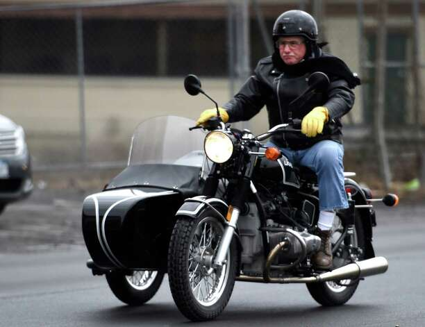 A hearty motorcycle rider takes a little jaunt down Broadway Tuesday afternoon March 17, 2015 in Menands, N.Y.     (Skip Dickstein/Times Union) Photo: SKIP DICKSTEIN / 00031062A