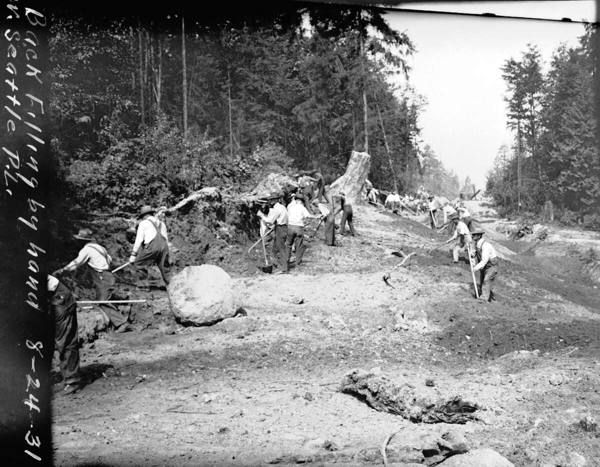 Men backfilling during a West Seattle pipeline project, pictured Aug. 24, 1931. The project is described as