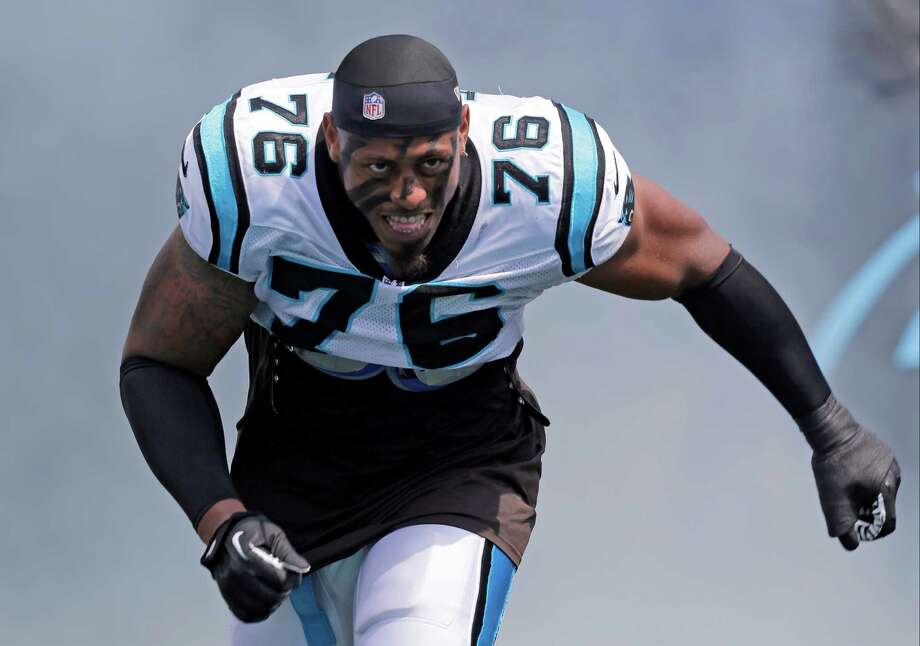 In this Sept. 8, 2013, file photo, Carolina Panthers defensive end Greg Hardy (76) is introduced before a game between the Panthers and the Seattle Seahawks in Charlotte, N.C. The Dallas Cowboys met with free agent defensive end Greg Hardy on Tuesday. Photo: Chuck Burton /Associated Press / AP