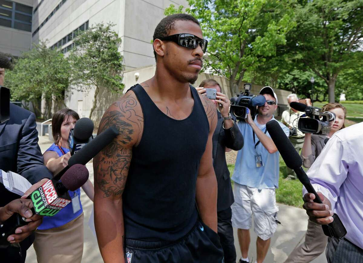 NFL defensive end Greg Hardy, then a member of the Carolina Panthers, leaves the Mecklenburg County jail after being released on bond last summer in a domestic violence case in Charlotte, N.C. A reader is disappointed the Dallas Cowboys recently signed Hardy to a contract.