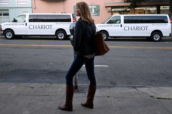 "Jennifer Gronski waits to board an inbound ""Chestnut Bullet"" Chariot commuter van in the Marina District in San Francisco, Calif. on Tuesday, March 17, 2015."